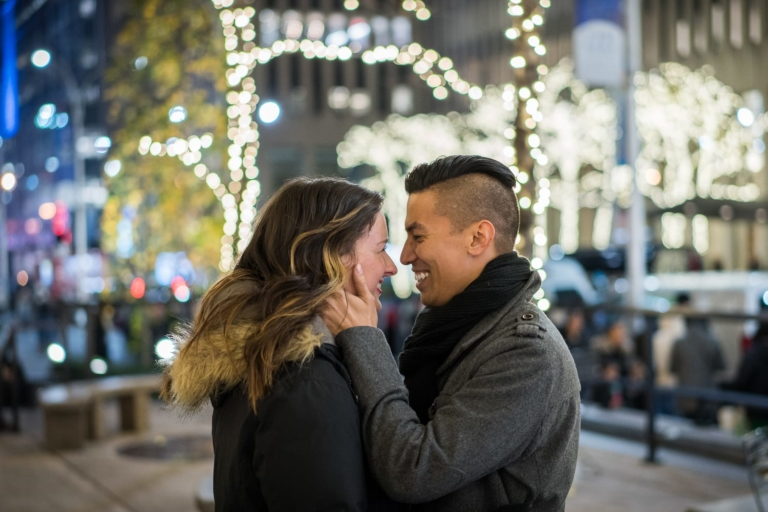 Engagement portrait in the city at Christmas.