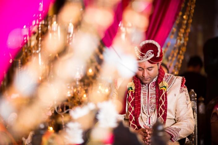 Indian groom prays at his wedding.