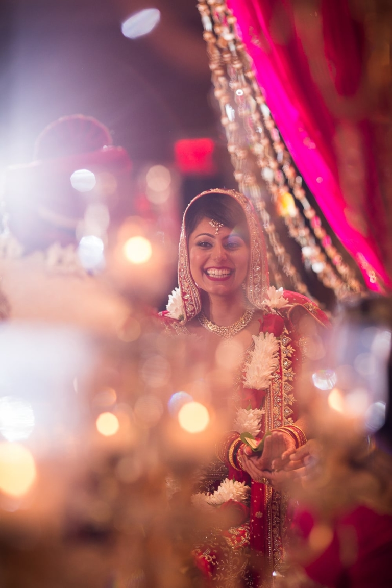 Indian bride smiles at her wedding.