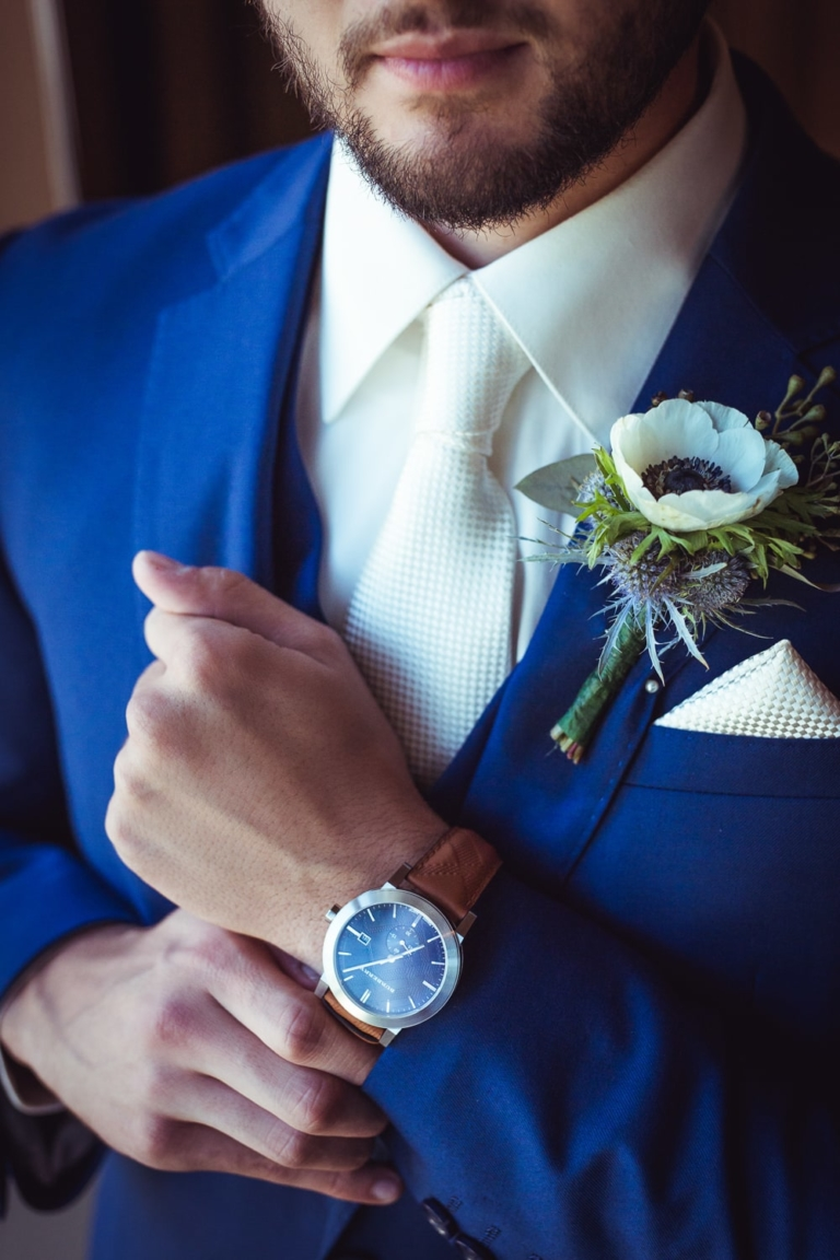 Groom portrait showing off Burberry watch.