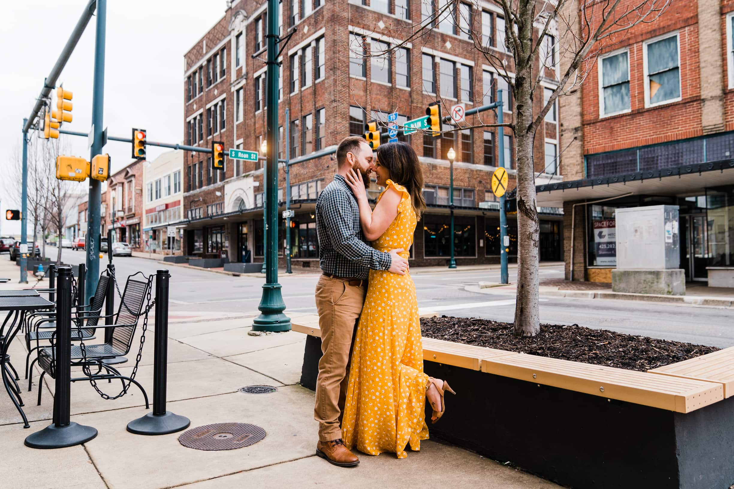 Engaged couple embraces at an intersection in Johnson City Tennessee