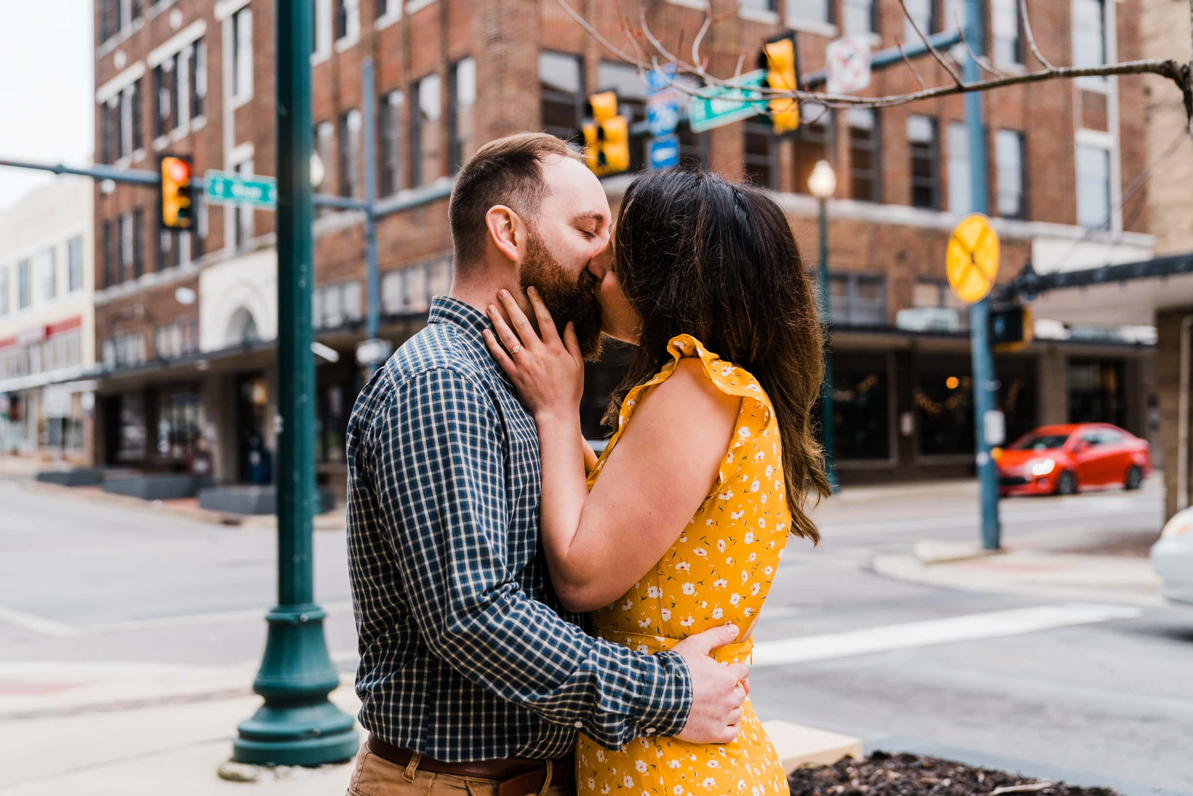 Engaged couple kisses at an intersection in Johnson City Tennessee