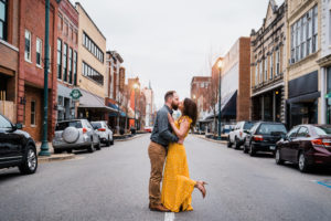 Engaged couple poses in the street Johnson City Tennessee