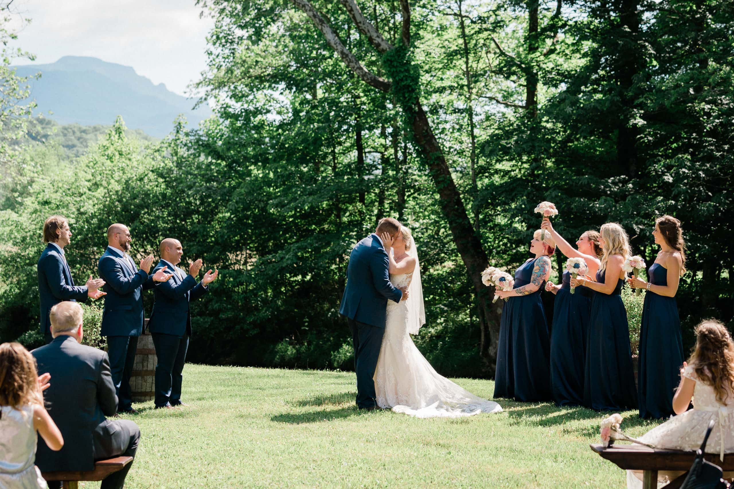 Wedding Ceremony on green grass with Granfather Mountain in the background