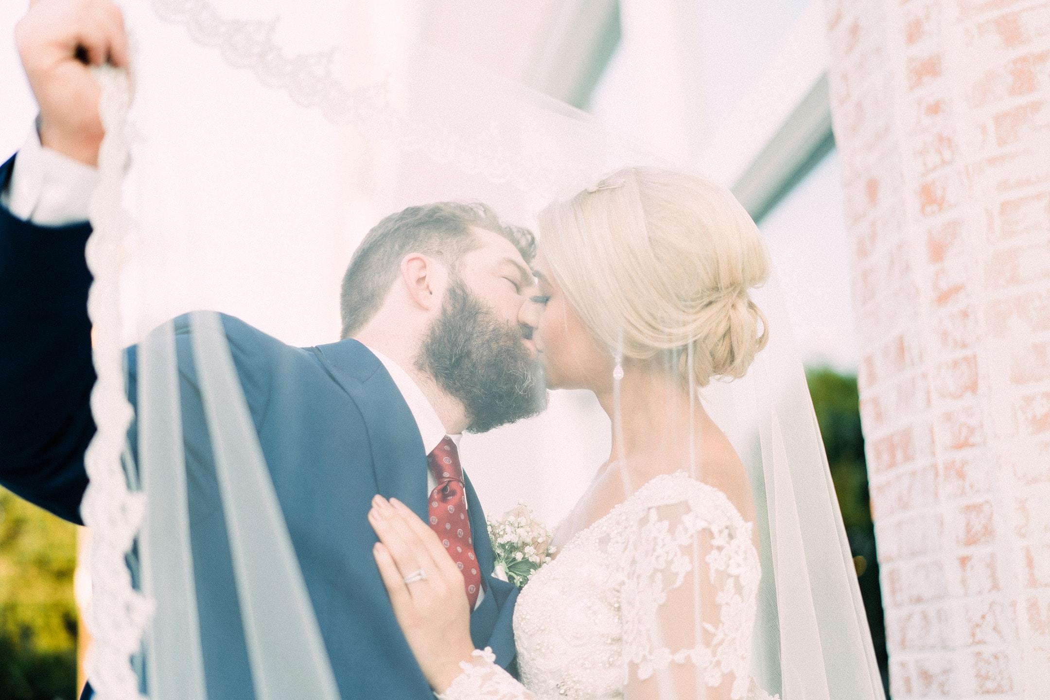 Couple kissed under bride's veil