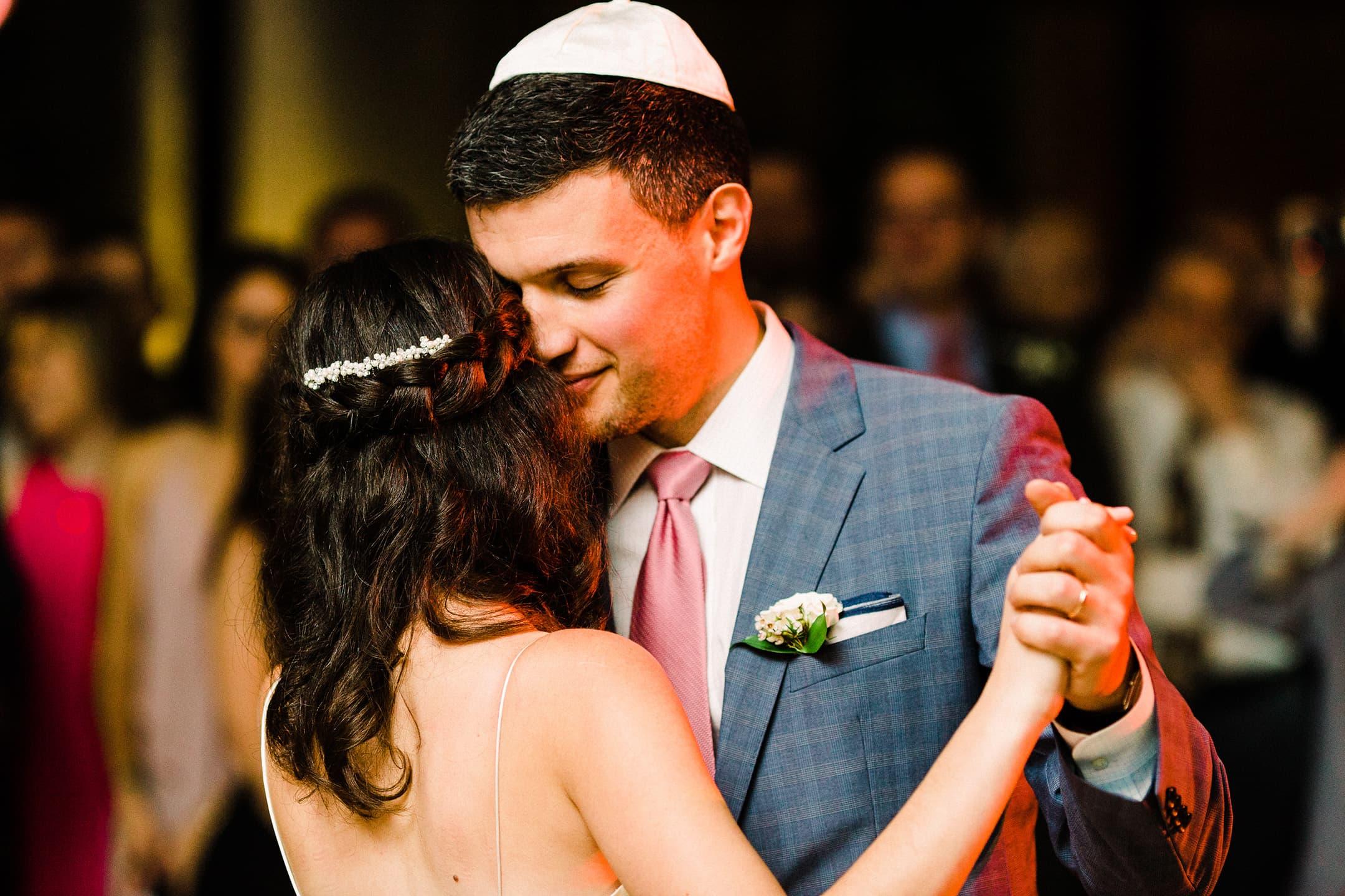 Jewish Groom dances with Bride at wedding