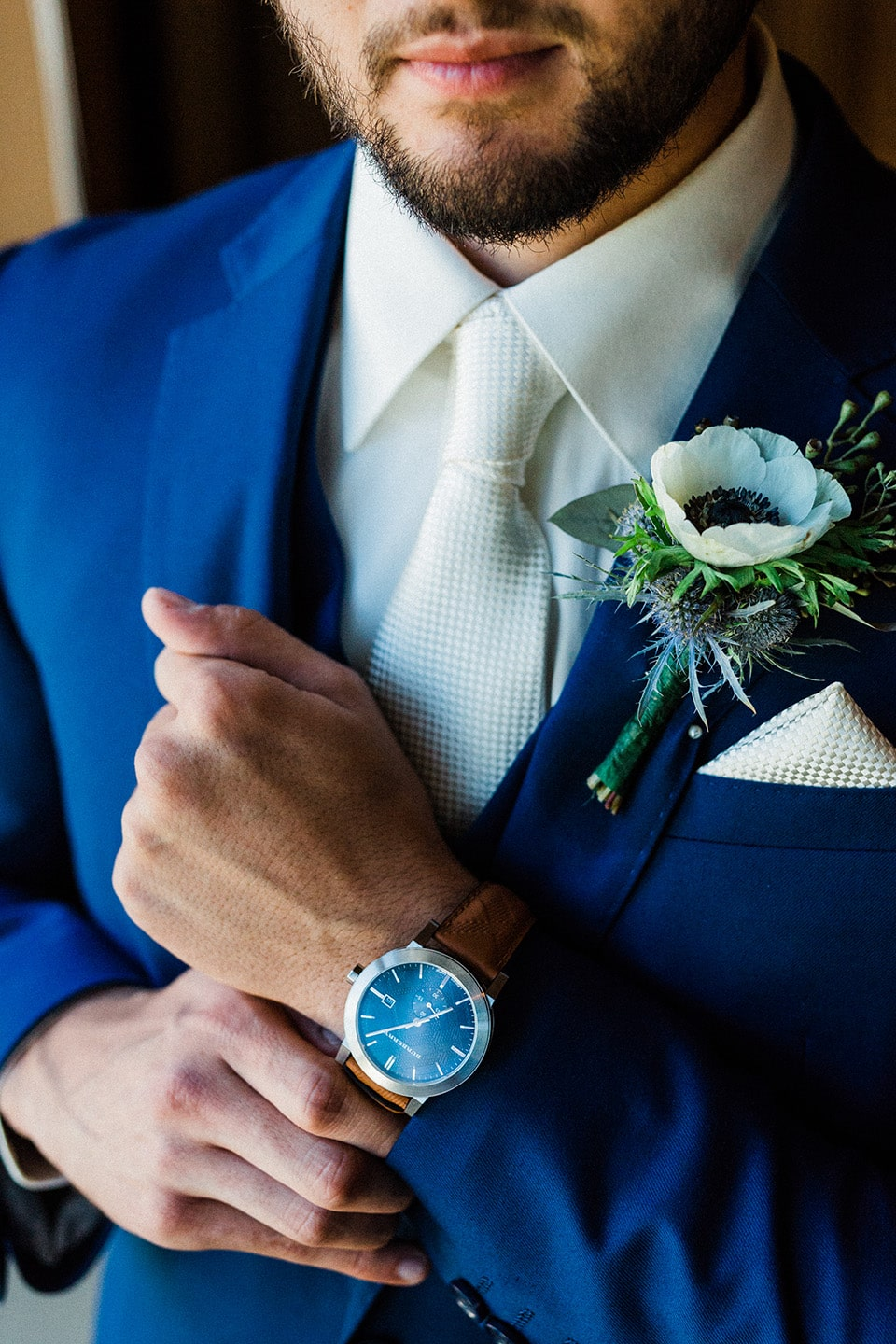 Groom shows off his Prada watch