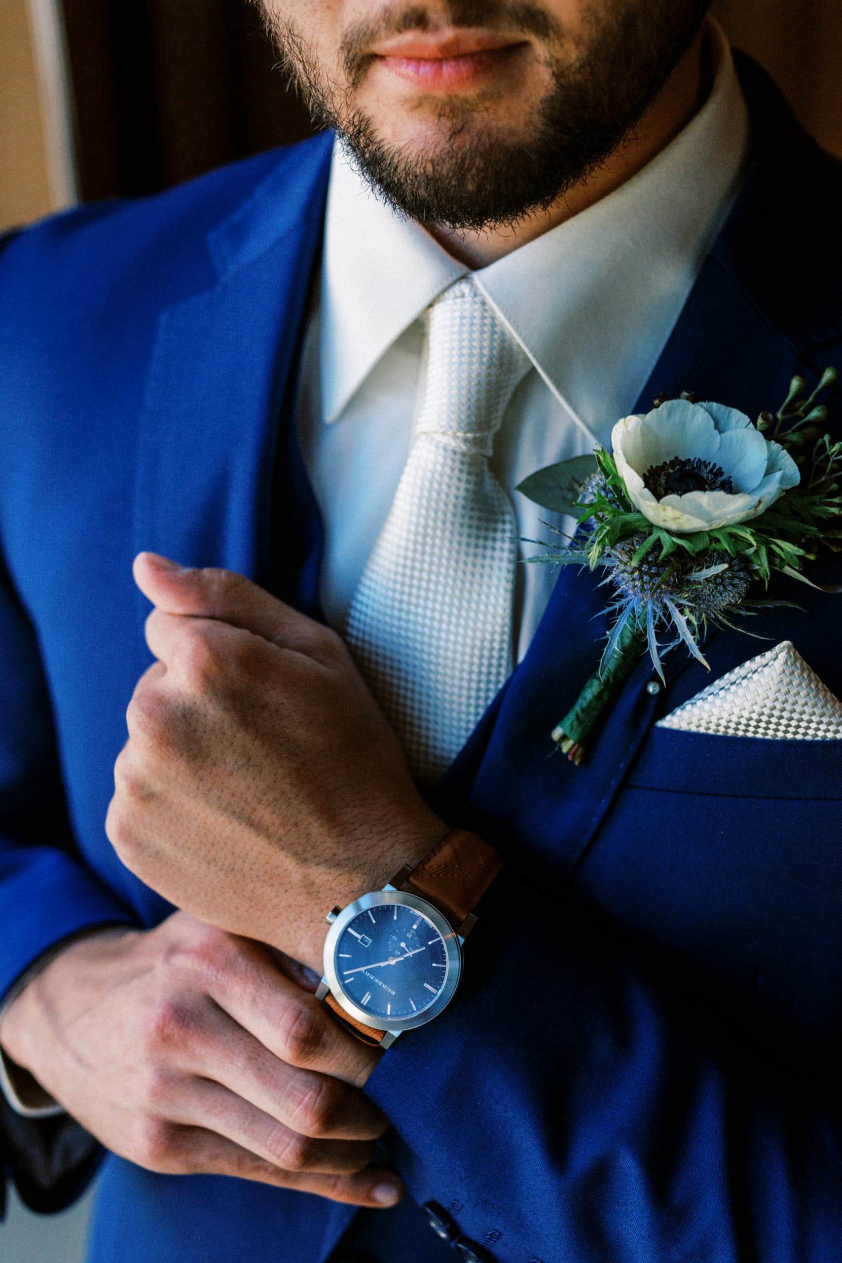 Groom shows off his Burberry Watch