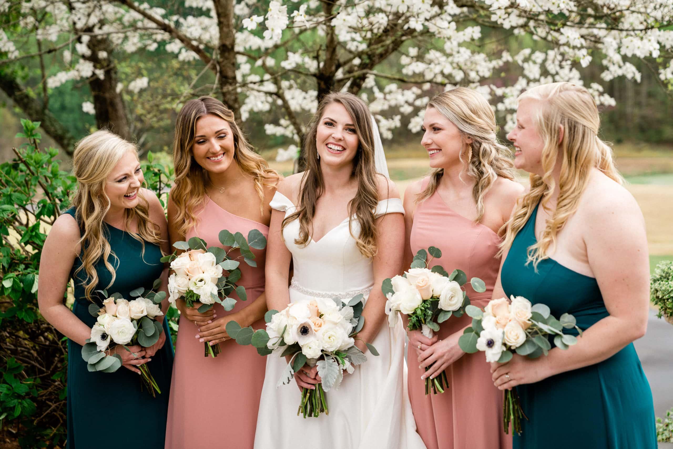 Bridal party smiling at the camera